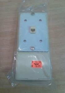 New/Old Stock Telephone Wall Mount: Ivory