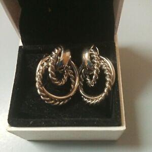 White gold hoop earrings with markings etc