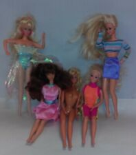 Mixed lot of five different barbies most clothed