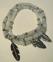 3x elasticated beaded bracelet with blue hue and silver tone metal feather charm
