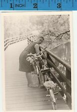 Vintage Photo Woman locks up bike to fence railing   #265