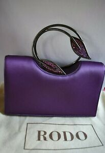 Glitzy royal purple Rodo clutch bag - new with tags and branded canvas bag