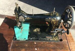 Antique Ward Bros Bendigo Sewing Machine Treadle machine in small pop up cabinet