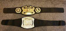 2x WWE Belts. Spinning Light Up Champ Belt 2010 & Tag Team Champions Belt 2005