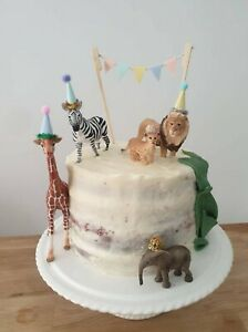 Mini party hats for animal dinosaur first birthday cake toppers