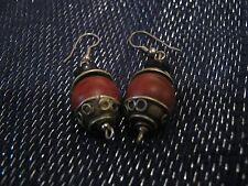 with brown faux wood bead Pair of silver tone metal earrings