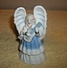 """A Porcelain Angle Bell 5 1/4"""" Tall"""