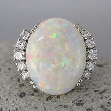 Ring mit ca. 0,65ct Brillant TW-vsi und einem Opal in 750/18K Weißgold