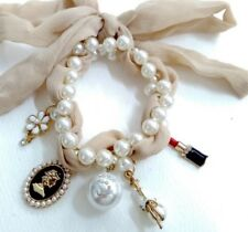 Trendy Designer Double Strand Pearl Bracelet With Five Charms & A Material Weave