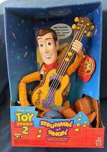1999 Disney Pixar Toy Story 2 Strummin' Singin' Woody sealed in original box