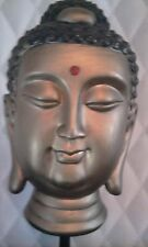 Lovely golden Buddha head statue on stand