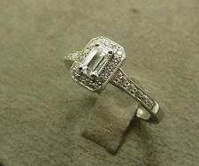 Platinum & Emerald Cut Diamond Cluster Ring. TDW 0.55ct, GIA Cert G, VVS2
