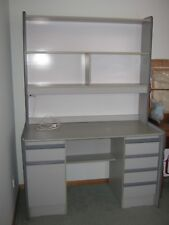 Desk. Grey with hutch. 5 drawers, bench and worklight.