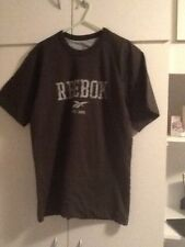 Reebok bottle green colour T shirt can be worn inside out.