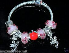 A pink flower and angel charms beads style bracelet ideal gift for girls