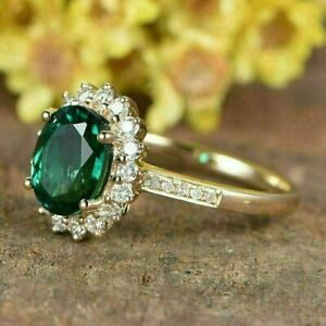 2Ct Oval Cut Green Emerald Halo Women's Engagement Ring In14K Yellow Gold Finish