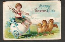 Happy Easter-tide embossed post card child riding on egg pulled by 2 baby chicks