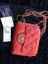 Authentic Chanel 3 pocket quilted red leather mini flap bag