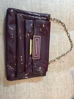 anya hindmarch burgundy patent leather clutch