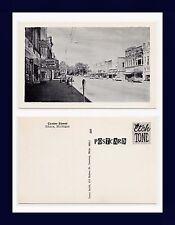 MICHIGAN ITHACA CENTER STREET, PHARMACY, MOVIE THEATRE, ET AL, CIRCA 1965