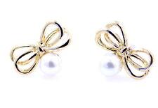 Sveglio eccellente arco tono oro e di perle orecchini
