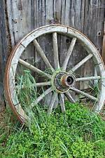 A Vintage Old Wooden Wagon Wheel Leaning Against Wall Journal  by Creations Cs
