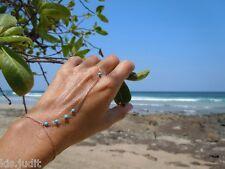 Bracciale anello baciamano con perline turchesi colore oro - Moda mare 2016