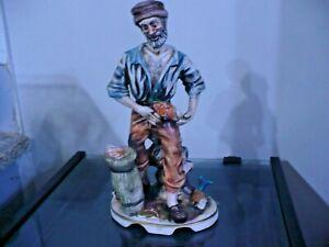 statua porcellana capodimonte pescatore pescivendolo
