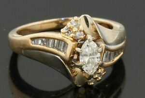 14K gold .67CTW diamond wedding/engagement ring w/ .30CT Marquise ctr. size 5.5