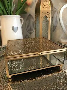 A Large Sleek Gold Cut Metal Decal Top Glass Mirrored Jewellery Trinket Box