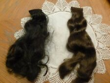 "Two welts of Human Hair, 9"" Long x 1 1/2"" Wide, One is Med. Brown the other Blk"
