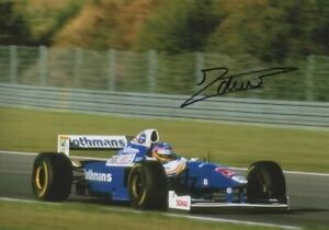 Jacques Villeneuve signed photo.Williams 1997. COA. 21X15