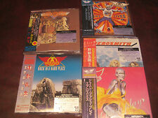 AEROSMITH COLLECTION OF 5 JAPAN REPLICA 2004 TITLES WITH ORIGINAL STICKER SET
