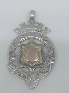 Antique solid silver and 9 carat rose gold watch fob in excellent condition.