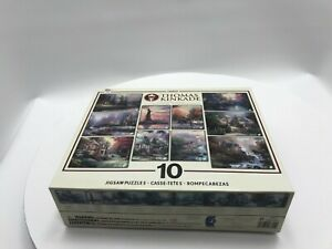 Lot of 10 Thomas Kinkade puzzles Painter of Light Collector's Edition