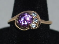 10k gold ring with an Alexandrite(June birthstone) and CZ's