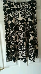 Ladies full panel skirt in cream with black floral pattern size 10 from South
