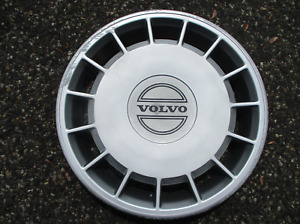 One factory 1989 to 1994 Volvo 240 14 inch hubcap wheel cover black letters