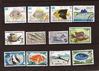 Tous pays lot de 12 poissons ,especes diverses  de mer et d'aquarium 28M 155T1