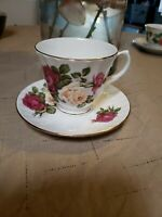 Royal Victorian cup and saucer Made in England, rose pattern.