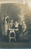 Woman and Three Children in Interesting Clothing and Hoop Real Photo Postcard