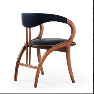 The Peru armchair features a solid beech frame