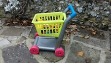 Childs plastic shopping trolley by E L C