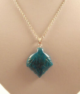 """Various semi precious gemstone leaf pendants and 18"""" silver plated chains."""