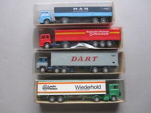 4 Wiking Trucks in 1:87 scale.