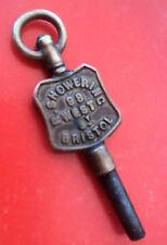 Advertising Pocket Watch Key -  R. Showering of  98 West Street Bristol in Avon