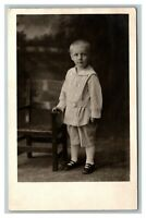 Vintage 1920's RPPC Postcard Photo of Cute Child Next to Chair