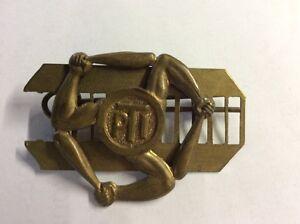 Military PTI brass badge