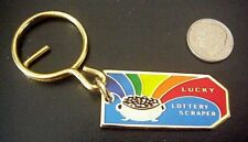 OFFICIAL VINTAGE LOTTERY COMMISSION LUCKY SCRAPER SCRATCHER POT OF GOLD KEYCHAIN