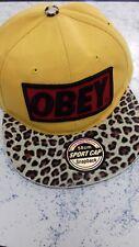obey. baseball cap. animal print peak/ bright yellow. snapback.